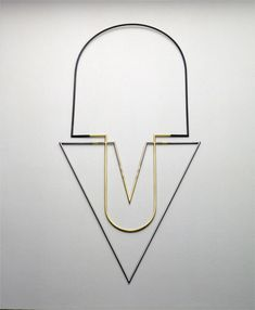 David Watkins neckpiece. Watkins's early jewellery designs featured minimal geometric patterns and were influenced by imagery of space objects and his work as a model maker for the film 2001: A Space Odyssey.