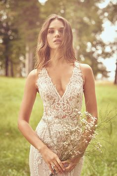 Cascading details elongate and accentuate the figure in this stunning Lillian West wedding dress. The fine details are simply breathtaking with embroidery and light beading. A gorgeous open halter back finish the gown. Lace Wedding Dress, Fit And Flare Wedding Dress, Fit Flare Dress, Wedding Dresses, Lillian West, Bobo Chic, Classic Wedding Hair, Wedding Dress Pictures, The Dress