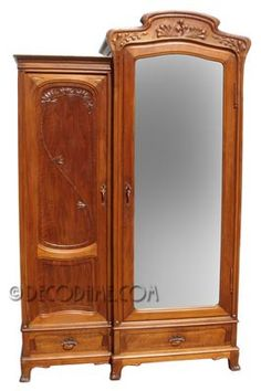 French Antique armoire created during the Art Nouveau era with classic Art Nouveau organic design details. Hand crafted of solid hand carved Walnut. Original complimentary Bronze hardware and keys.