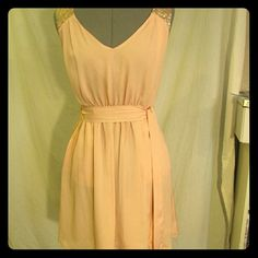 NWOT Satiny blush beauty w/gold sequin detail! A peach of a dress! Darted front top with gold sequins at shoulder and through back. Champagne blush color with front pockets. Deep v-neck front and keyhole back. Button closure, elastic waist with belt. Hits at knee. Great for a wedding, elegant party or other special occasion! Never worn, perfect condition, no missing sequins, pulls or loose threading. Dresses Mini