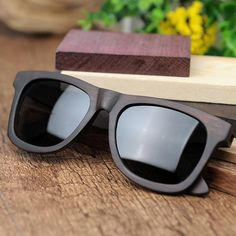 Cheap sunglasses with, Buy Quality wood fashion sunglasses directly from China wood sunglasses Suppliers: BOBO BIRD Retro Ebony Wooden Sunglasses With Grey Polarized Lens And Fashion Design Laser On Wooden Frame Dropshipping OEM Wooden Sunglasses, Polarized Sunglasses, Mens Sunglasses, In China, Ebony Color, Wooden Frames, Designer, Fashion Design, Men's Fashion Styles
