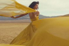 Taylor Swift yellow gown in new 'Wildest Dreams' Music Video. A mustard gown with a dramatic train blowing in the breeze is the epitome of standing in a nice dress, staring at the sunset, and is etched into the mind of your former lover forever. #Taylorswift #WildestDreams Dresses Short, Nice Dresses, Taylor Swift Outfits, Dream Music, Yellow Gown, Beautiful Eyes, Senior Pictures, Music Videos, Gowns