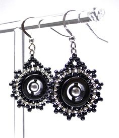 Classic dark grey and silver drop earrings in glass beads, Swarovski pearls and haematite Circular handbeaded drop earrings hung on sterling silver hooks Size: 2.5cm x 2cm Unique modern beaded jewellery that will add a touch of joy to your day when worn.  #DaniCromptonDesigns  www.dani-c.co.uk