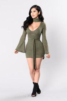 - Available in Ivory and Olive - Mock Neck - V Neckline - Bell Sleeve - Thick Attached Belt - Asymmetrical Bottom - Made in USA - 81% Polyester 15% Rayon 4% Spandex