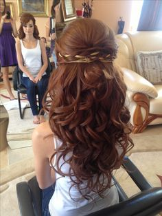 This braided wavy style is becoming more and more popular with younger brides. The braid adds a bohemian feel for the more laid back bride and the more carefree wedding.