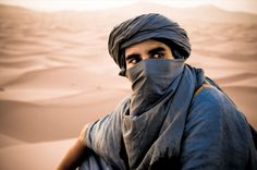 Berber camel driver by in African people