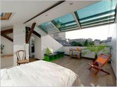 Une verrière à ouverture totale sur les toits de Paris