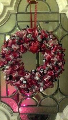 Valentines Day wreath that I made, Its my first one,it only took two days,a lot of ribbion and a lot of pins but so much fun. Email me for directions,I havemt figured out all of this Pinterest stuff