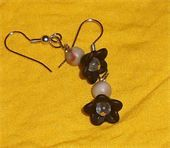 In Bloom Black bell flowers and imitation jasper. Clear glass bead for the flowers center. Silver fish hook earrings. Price: $6.50