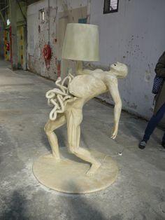http://iheardin.com/wp-content/uploads/2012/01/Joep-van-Lieshout-Human-Lamp.jpg