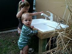 Second hand sink hooked up to hose.  I may have to try this one for our little one!
