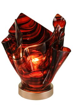 14 Inch W Metro Cabernet Swirl Glass Accent Lamp - 14 Inch W Metro Cabernet Swirl Glass Accent Lamp Theme: ART GLASS CONTEMPORARY Product Family: Metro Cabernet Swirl Product Type: NOVELTY LAMPS AND ACCESSORIES Product Application: Color: CABERNET SWIRL (RED ) Bulb Type: MED Bulb Quantity: 1 Bulb Wattage: 60 Product Dimensions: 11H x 11.5WPackage Dimensions: NABoxed Weight: 4 lbsDim Weight: 48 lbsOversized Shipping Reference: NAIMPORTANT NOTE: Every Meyda Tiffany item is a unique handcrafted…