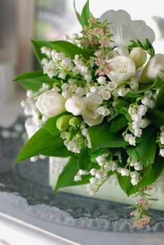 Lily of the valley and white crocus floral arrangement
