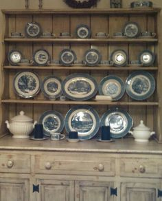 Currier and Ives dishes. I have the plates. Now I got to find the rest of the set and display them like this