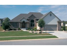 Traditional Ranch Home With Arch Window - plan 026D-0112 | houseplansandmore.com