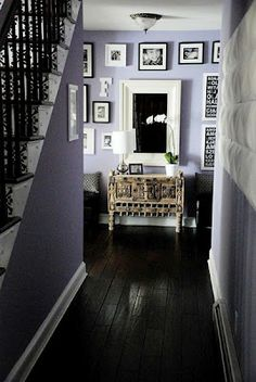 Lavender painted walls against white trims and dark floorboards ~ with gorgeous black and white accessories.