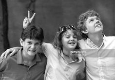 Henry Thomas, Drew Barrymore and Robert MacNaughton look out for. E.T.