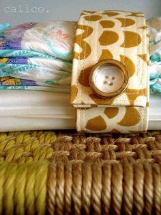 Diaper wrap tutorial. This could be used for other things.  Strap favorite stuffed animal and book together for car ride, etc.  Great for using up nice scraps of fabric that you don't want to throw away:)