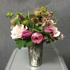 Pink bouquet in a silver mercury vase, with Hellebores, Ranunculus, Tulips and berries, by Gardenia Organic