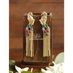 Beautiful peacock design earrings with multi-color stones.