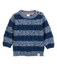 Dark blue/striped. Cable-knit sweater in soft fabric with wool content. Stocking-stitch back section and buttons on one shoulder.