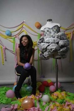 Atiyah Anderson, 14, from Detroit's Henry Ford Academy for Creative Studies with her newspaper prom dress in the photo studio of the Detroit Free Press, Tuesday, May 1, 2012. DIANE WEISS/Detroit Free Press