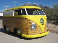A shortened 1960 VW microbus with hand painted woodie motif .