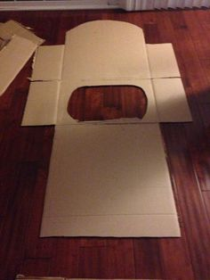 Cut out the shape of your roller coaster seat. We rounded the top, and cut an oval opening for you to insert self. Also left the side flaps to fold and be the side of the coaster.
