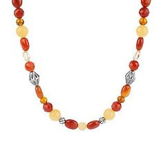 Oozing with warmth. Round and oval faceted carnelian, rough-cut yellow calcite, round yellow aragonite, round amber, and irregular oval citrine gemstone beads join to create this multicolored beauty. Stations of ribbed sterling silver beads--some diamond-shaped and some twisted and round--add a touch of glimmer. From Carolyn Pollack Sterling Jewelry.