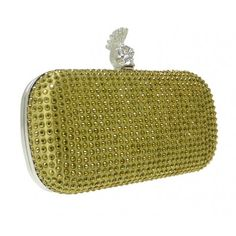 A clutch bag filled with small studs which shine from light and the open of the clutch bag is from a skull with a Mohawk hair on top, a unique fashion choice.