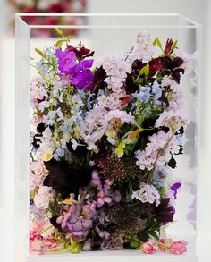 Instead of an arrangement coming out of the top, try inside the vase