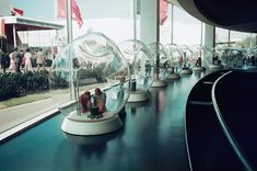 """1939 NY Fair: """"The Glass Incorporated Pavilion instructed visitors about the history of glassmaking with models encased in glass bubbles. Ah, the virtues of transparency!"""""""