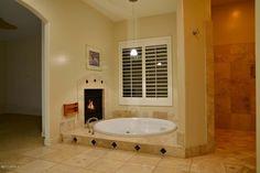 Master Bath Ideas: Dreamy sunken bathtub with fireplace and wrap around shower