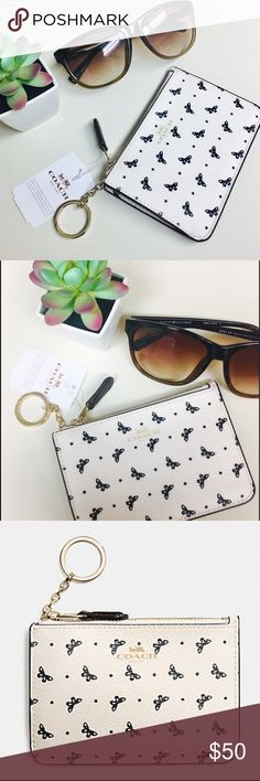 """💕Coach -NWTs butterfly key pouch💕 🆕NWT Coach💕 stunning chalk and black butterfly key/coin pouch💕 5""""x3 1/2""""-black lining; dark lining is perfect for keeping in mint condition-gold tone hardware-leather lining. So adorable‼️would make a perfect gift, trendy multi purpose key chain, or mini wallet💕( 🎁mystery gift with purchase!) does not come with Coach box pictured. Coach Accessories Key & Card Holders"""