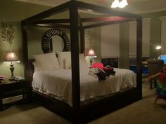 Beautiful wooden canopy bed!