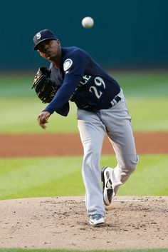 Roenis Elias Photos Photos - Roenis Elias #29 of the Seattle Mariners throws a pitch during the first inning of the game against the Cleveland Indians at Progressive Field on June 9, 2015 in Cleveland, Ohio. - Seattle Mariners v Cleveland Indians