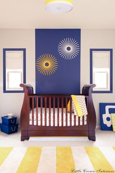 I think this could go for a girl or boy- maybe more light blue accents for a girl and some purple?  I'm trying to think of color ideas for if someone decides not to find out the gender of the baby ahead of time...  Modern nursery design with bold pops of color!