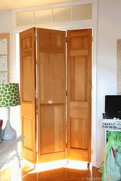"""Thrift-store-bifold-doors-made-into-a-rolling-door @Debby Wright ... @Tony Wright could totally make these as fake office """"French doors"""" and you could use doors with window panes! Look at the post!"""