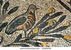 Ancient Roman mosaic of a partridge perched on a branch in the UNESCO golden mosaic floor of Aquileia Basilica.