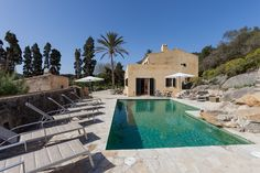 VILLA LA CALA approached up a long pine tree lined driveway this spectacular two storey villa has a large ground floor terrace and an upper terrace following the length of the villa.
