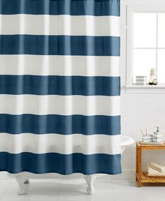This Kassatex Hampton Striped Shower Curtain gives you the bold, graphic impact of stripes, and the modernity of horizontal stripes (vs. vertical). The color coordinates with your tile without competing, yet adds visual interest and draws the eyes into the back room of the powder room.