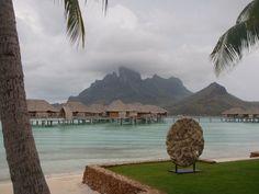 Overwater bungalows in beautiful Bora Bora, French Polynesia.