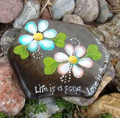 Hand Painted Idaho River Rock-Acrylic Original-Coral and Teal Daisies-Inspirational-Life is a Song-Love Music-Paper Weight-Shelf Sitter by Paintinstuff on Etsy https://www.etsy.com/listing/524497291/hand-painted-idaho-river-rock-acrylic