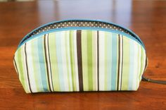 Take your essential oils with you in this beautifully hand sewn carrying case. What you will LOVE: The unique, open wide design, allows for easy access. No more do you have to peer down into your oils pouch searching for the right bottle. This pouch lies flat so you can see your oils at a glance. A softly padded cotton exterior will keep your precious oils safe while the laminated cotton interior keeps your purse or tote bag clean and dry should your bottles leak. (and they do!) The elastic…