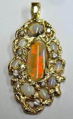 Opal and diamond 14 karat yellow gold pendant. Opals supplied by client. Designed and Created by BGS.