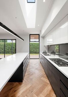 Add value and instant 'wow' factor to your home with our award winning kitchens and bespoke cabinetry. Contemporary Skylights, Contemporary Kitchen Design, Kitchen Cabinetry, Kitchen Flooring, Open Plan Kitchen Living Room, Long Narrow Kitchen, Kitchen Interior, Kitchen Decor, Küchen Design