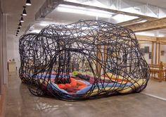 """""""Nest: Art of Space"""" Polyethylene irrigation tubing, cable ties, fabric and shredded paper. 