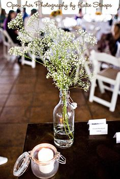 baby's breath centerpiece-I'm so in love with this idea! :) baby's breath will be all in my wedding