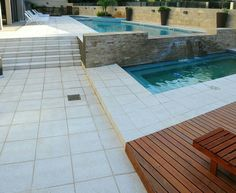 Infinity Swimming pool with Patio by Culzoni decking and coping