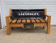Made with a 1950 Chevy tailgate and an Indiana 1963 truck license plate. The frame is made with pine and cypress for the seat. By Jim Owens